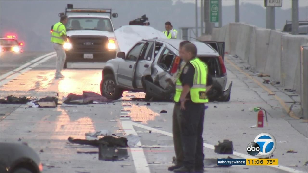 Law enforcement officials are seen on the 5 Freeway in Arleta, where a fatal, multi-car wreck occurred on Friday, Sept. 15, 2017.