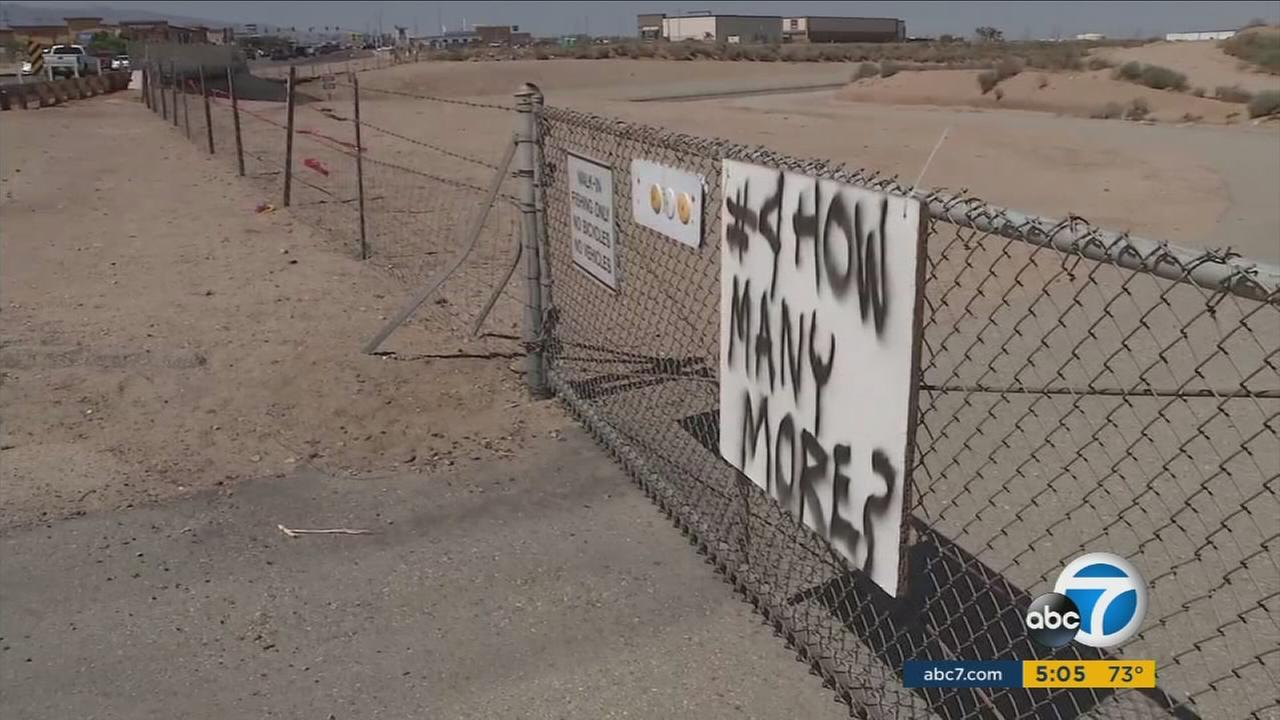 A sign near the California Aqueduct in Hesperia asks how many more people have to die before something more can be done.