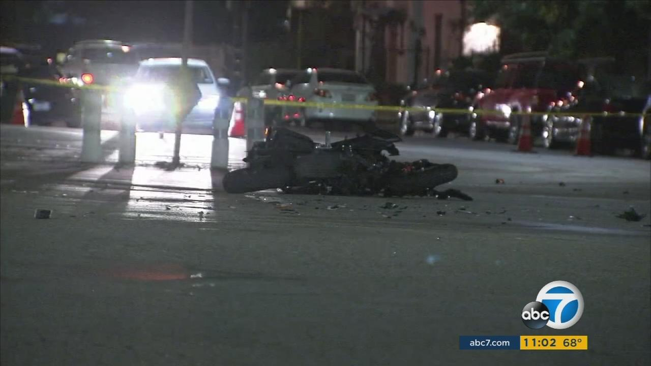 A mangle motorcycle is shown at a intersection in Pacoima after a hit-and-run crash that left the rider dead on Saturday, Sept. 16, 2017.