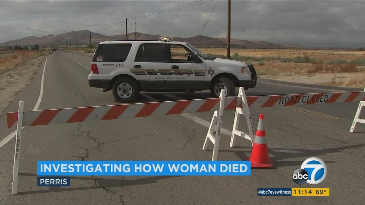 The death of a woman whose body was found Thursday morning on a road in Perris was being investigated as a possible hit-and-run crash, authorities said.