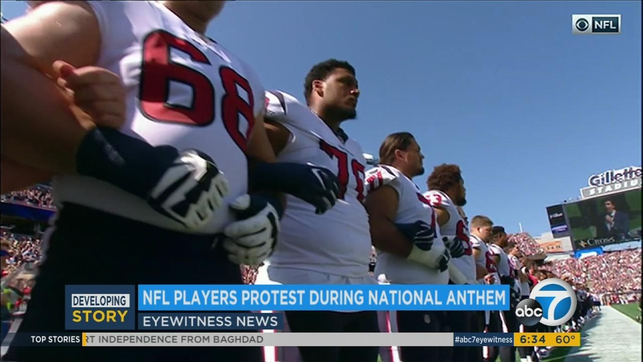 NFL players lock arms during the national anthem on Sunday, Sept. 24, 2017.