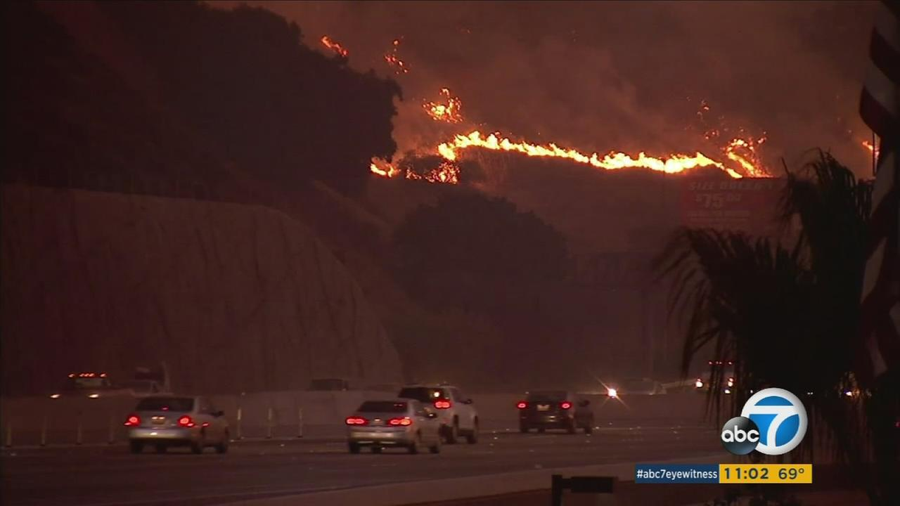 Flames lapped at dry brush right along the eastbound 91 Freeway and near the Anaheim-Corona border on Monday, Sept. 25, 2017.