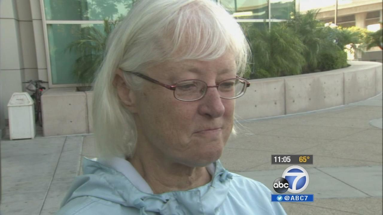 Marilyn Jean Hartman, 62, speaks outside a Los Angeles courthouse on Wednesday, Aug. 6, 2014, after being sentenced for sneaking onto a flight from San Jose to Los Angeles.