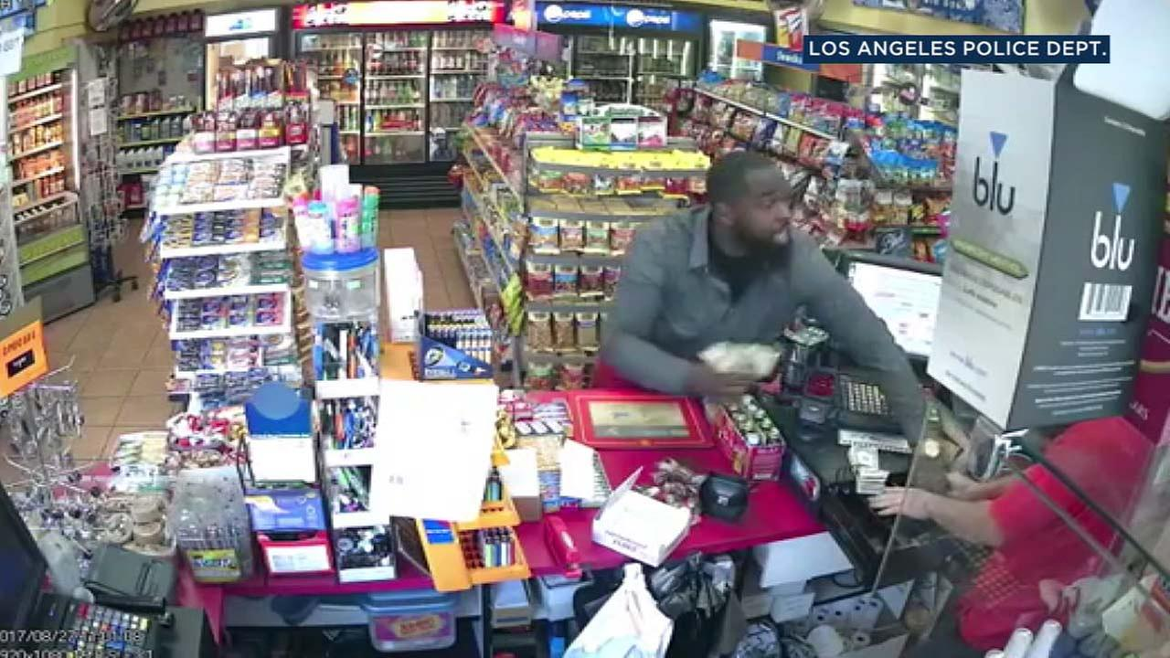A suspect is seen in surveillance footage grabbing cash from a cash register from a  gas station in East Hollywood in August.