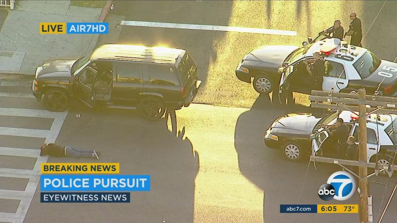 Authorities take a chase suspect into custody in South Los Angeles.