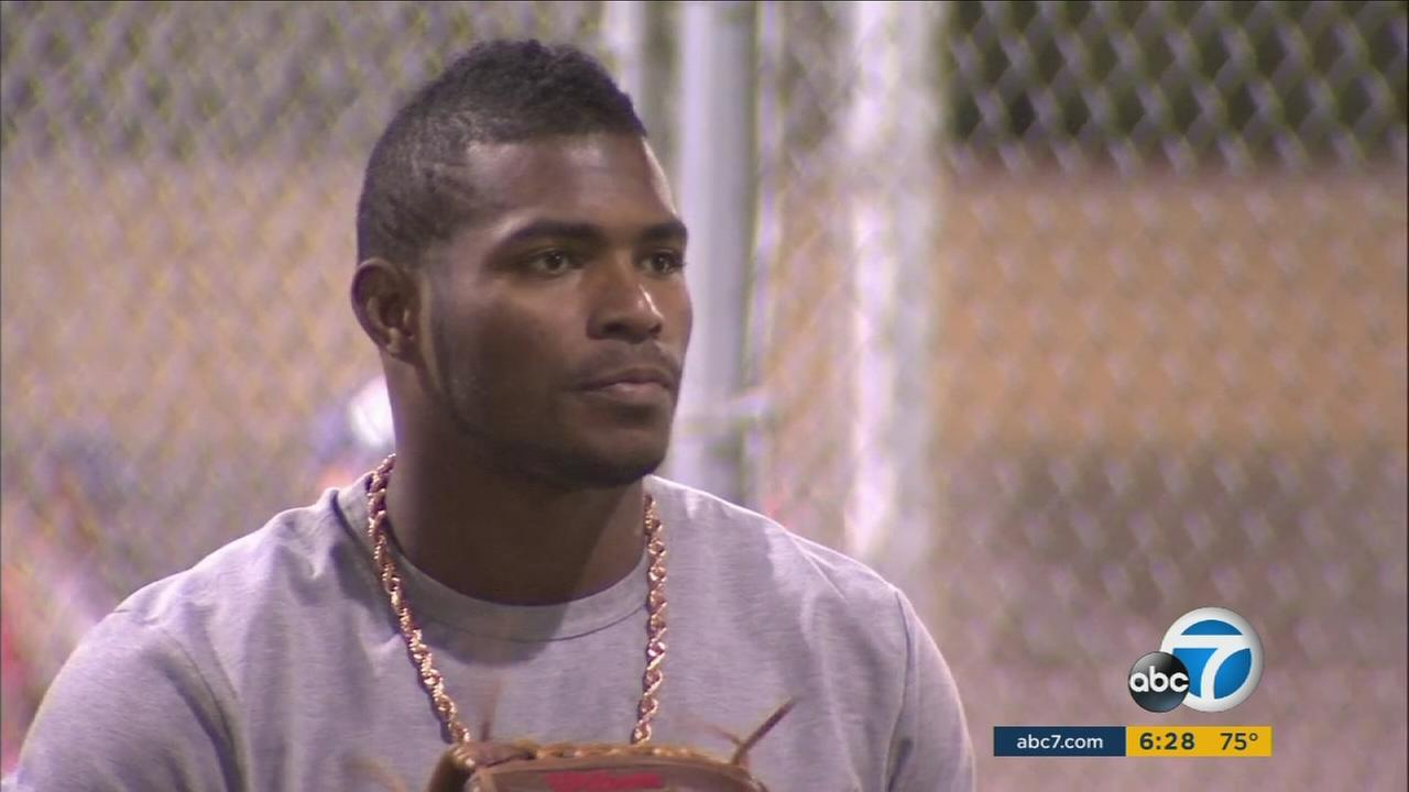 Dodger Yasiel Puig is shown practicing with children from a youth baseball team in Encino.