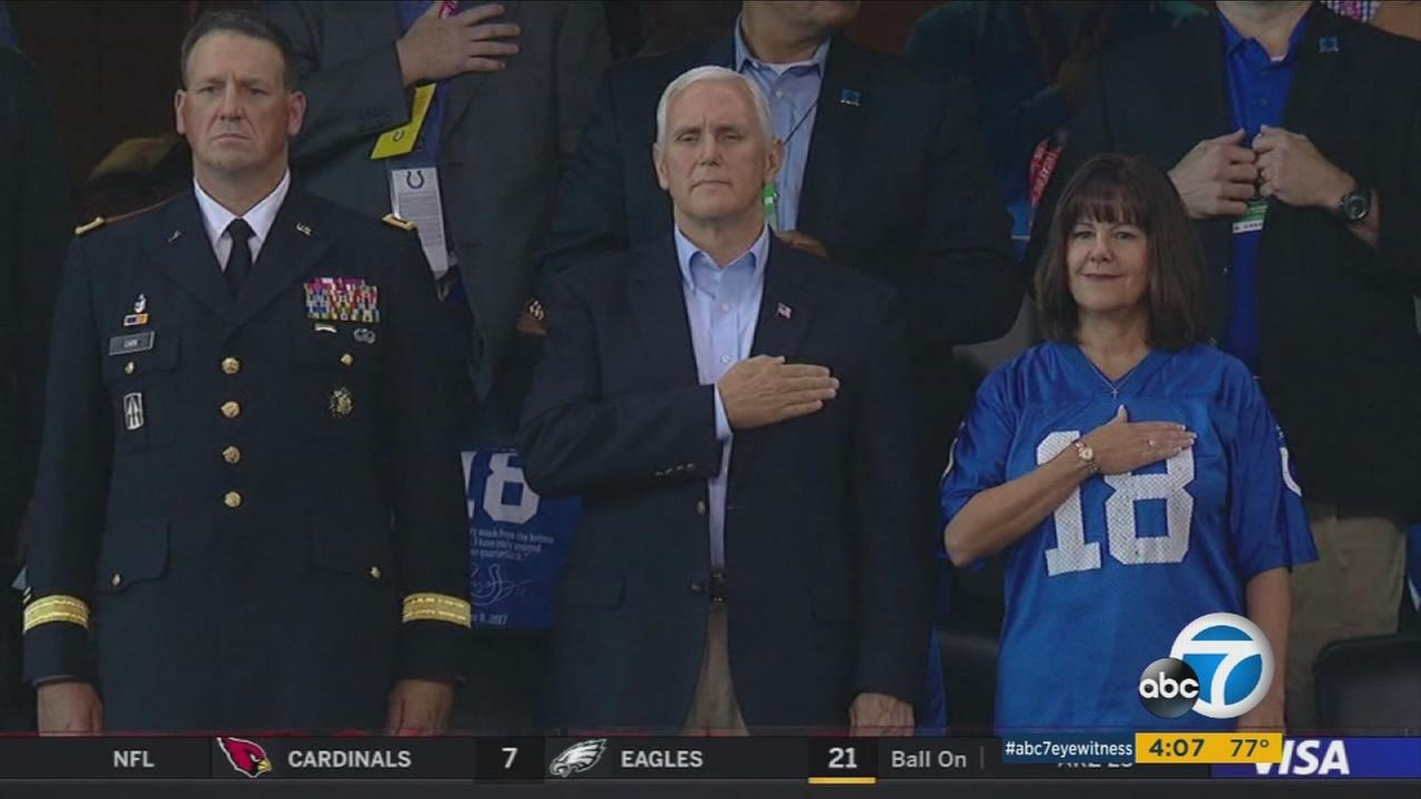 Vice President Mike Pence and his wife put their hands over their hearts at an NFL game in Indianapolis, while several San Francisco 49ers players knelt.