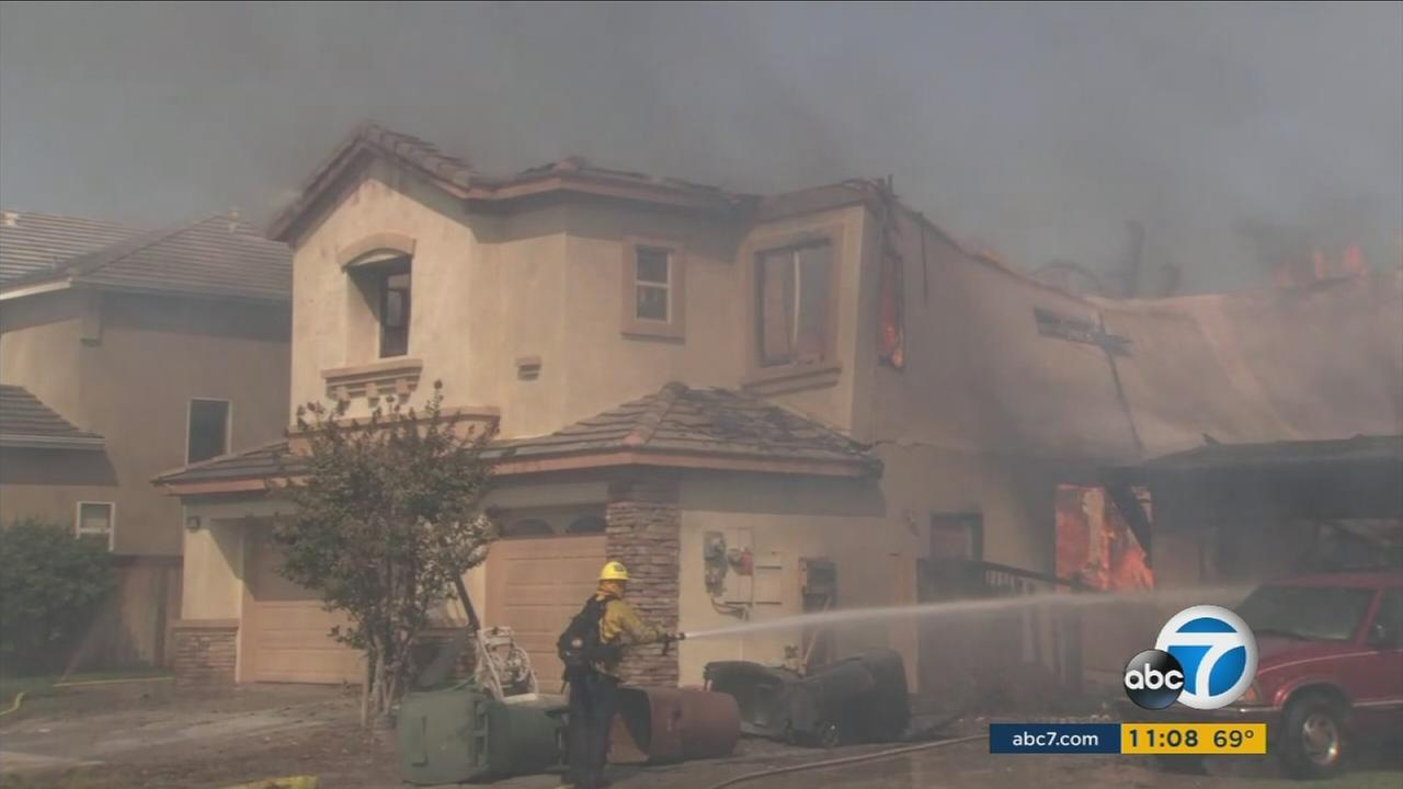 An Anaheim Hills home partially collapses in the Canyon Fire 2 on Monday, Oct. 9, 2017.