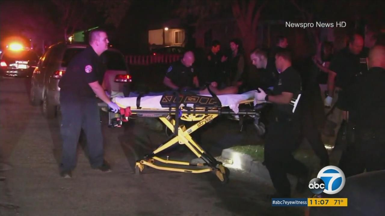 A woman who was shot in the head during a robbery attempt is wheeled away into an ambulance on Wednesday, Oct. 11, 2017.
