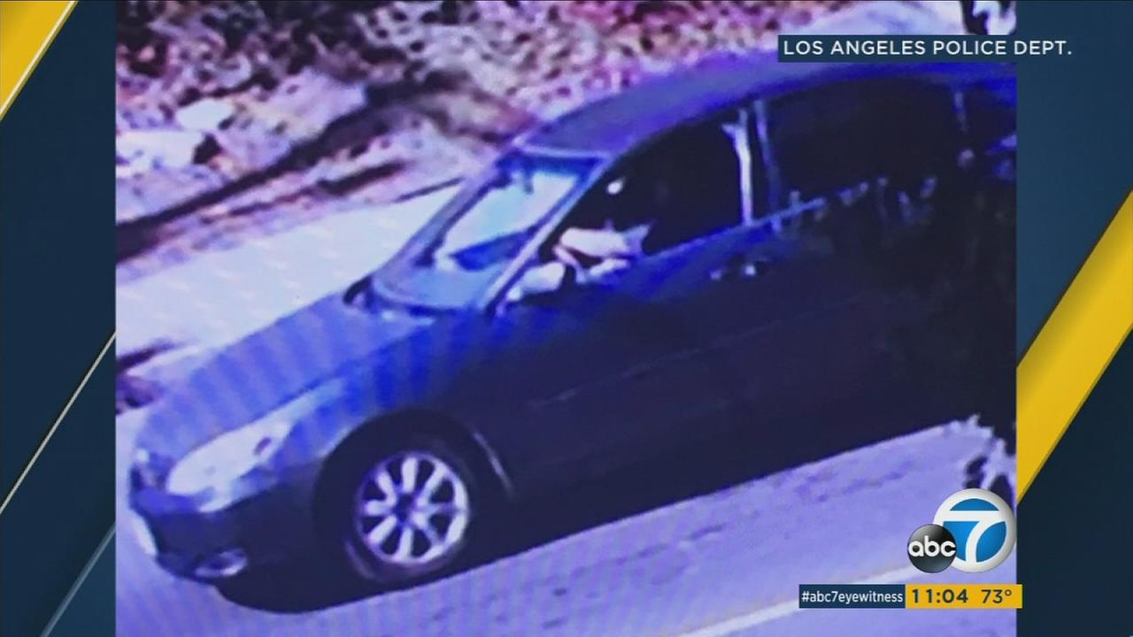 Surveillance video shows a sedan with a suspect shooter inside after the person opened fire on an SUV driver in Lake View Terrace on Monday, Oct. 16, 2017.
