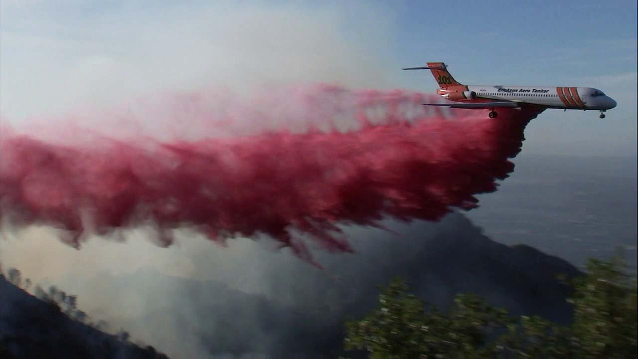 An aircraft drops fire retardant along the hillsides of Mount Wilson on Oct. 17, 2017.