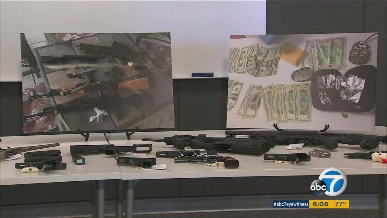 Guns, money and drugs are shown in photos. The items were all acquired during a sting operation in four San Bernardino County cities and towns.