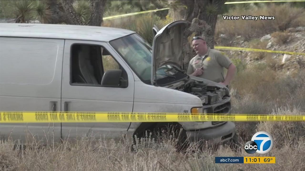 Authorities search a van for clues after a man led them on a short chase and after opened fire on them in Pinon Hills on Wednesday, Oct. 18, 2017.