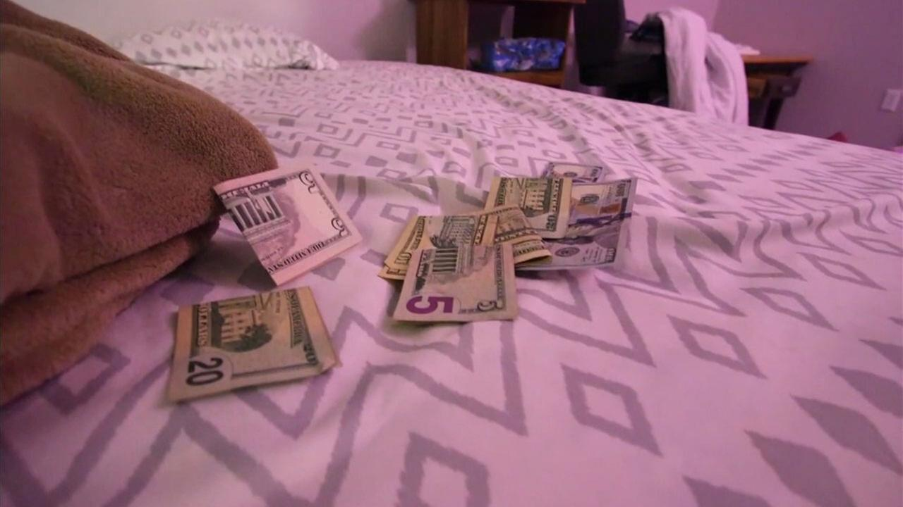 Money is shown on a bed inside a motel room as FBI agents raided the area searching for sex trafficking victims.