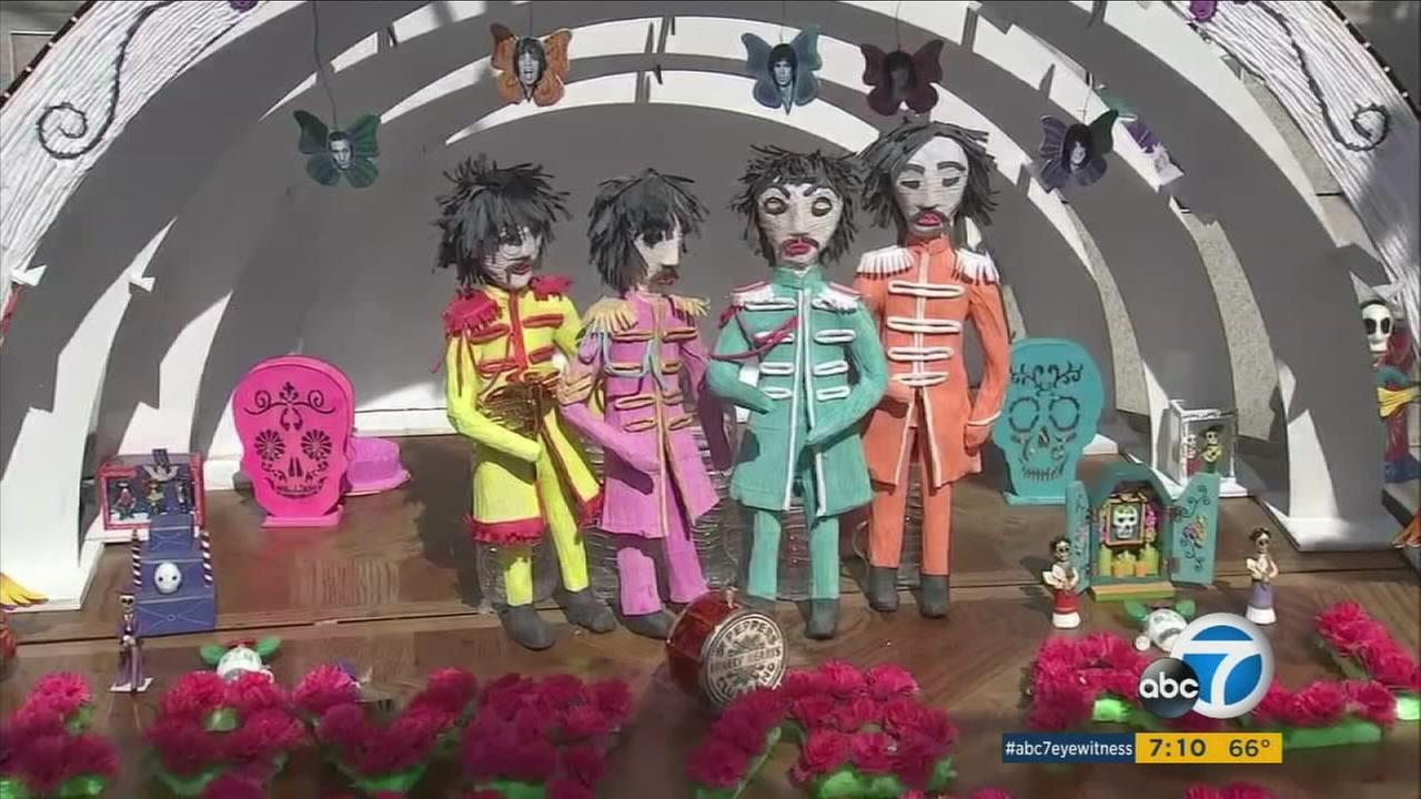 All four members of The Beatles are shown as skeletons at a Dia de los Muertos altar at the Hollywood Forever Cemetery event on Saturday, Oct. 28, 2017.