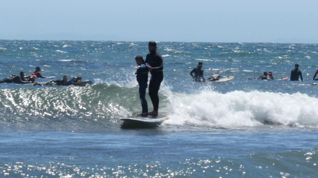 The A Walk on Water organization, which offers surf therapy, holds seven events yearly for families with children who have special needs.