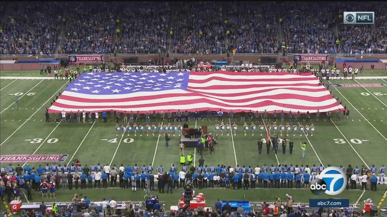 The national anthem being played at an NFL game.