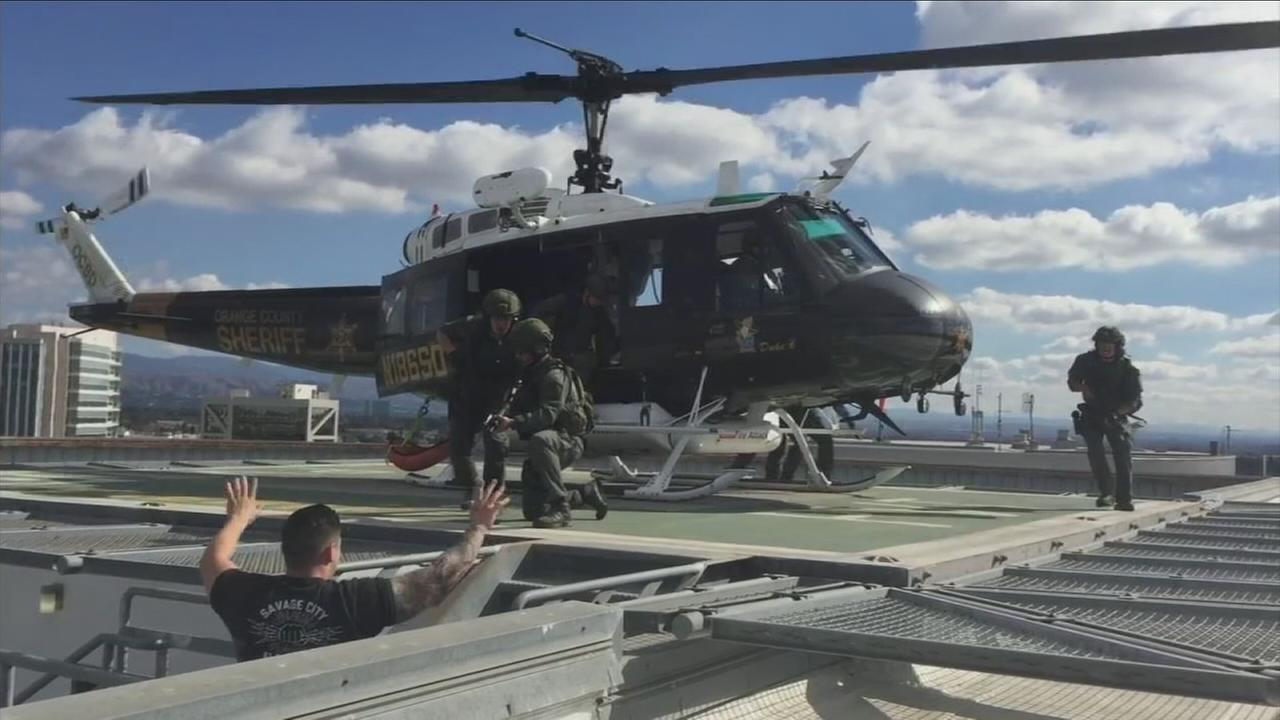 Members of the Santa Ana police SWAT team and the Orange County sheriffs air support participated in drills, preparing them to deal with an active-shooter situation.