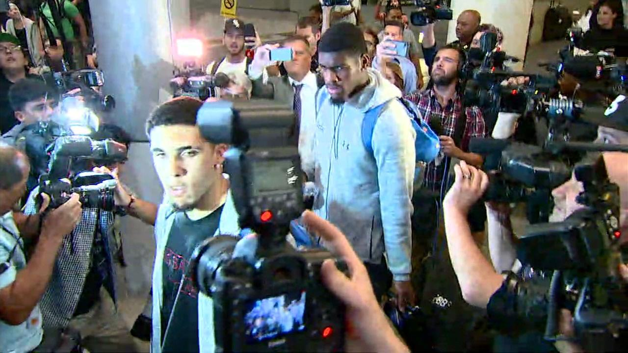 UCLA players accused of shoplifting in China are swarmed by photographers and reporters at Los Angeles International Airport as they arrived from China on Tuesday, Nov. 14, 2017.