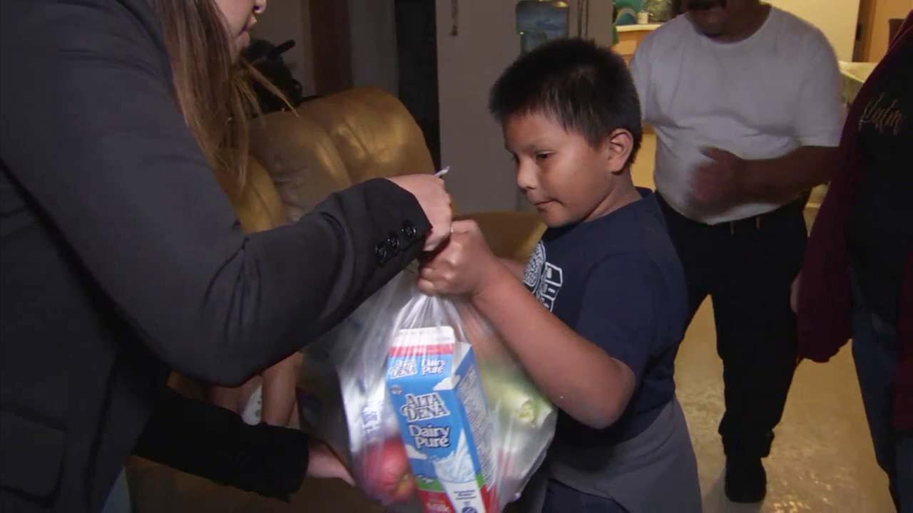 Emmanuel Munoz receives a reward for succeeding in an Anaheim anti-gang program.