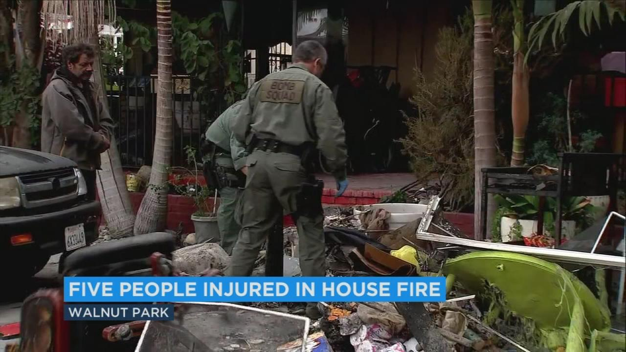 At least five people were injured when a fire erupted early Friday morning at a Walnut Park house that is home to 31 people.