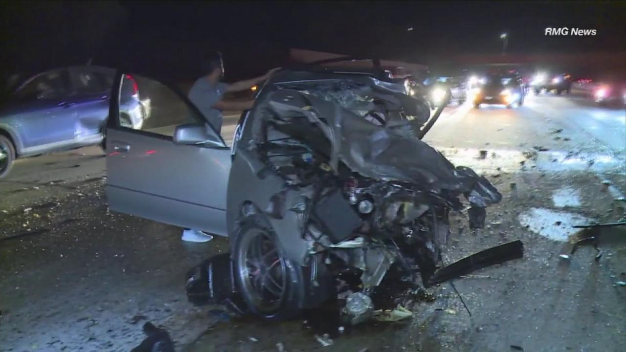 A mangled 2003 Lexus sedan is shown on the eastbound 118 Freeway near Porter Ranch after the driver collided head-on with a wrong-way driver on Sunday, Nov. 19, 2017.