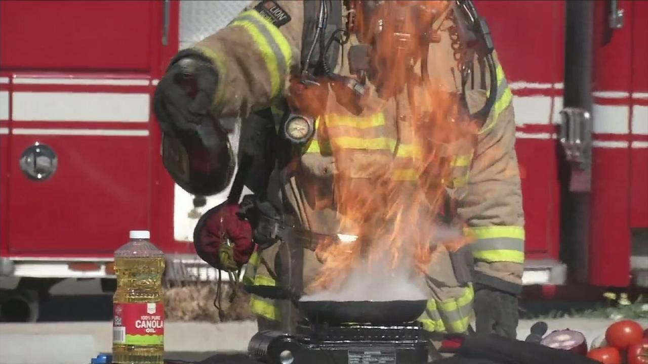 A fire erupts in a pot of oil as a firefighter demonstrates how not to fry a turkey this Thanksgiving.