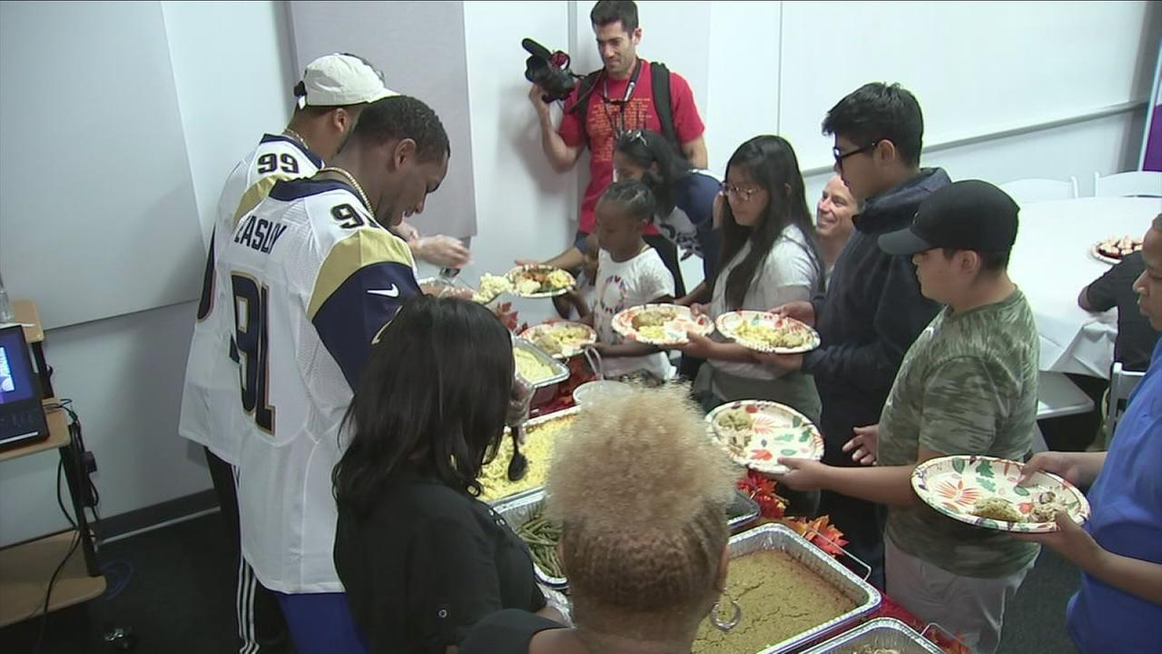 Rams defensive end Dominique Easley recruited All-Pro teammate Aaron Donald to help him serve Thanksgiving dinners Tuesday to 30 Los Angeles families in need.