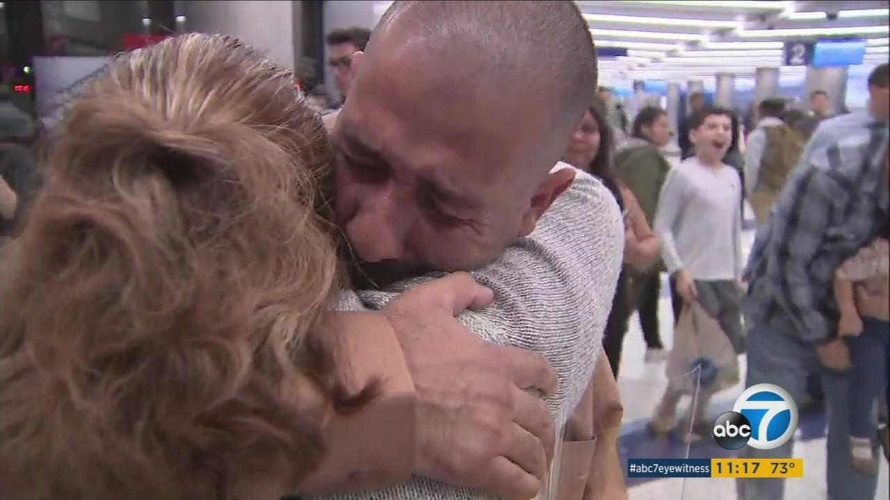 A brother and sister embraced for the first time since their family was split apart by divorce more than three decades ago.