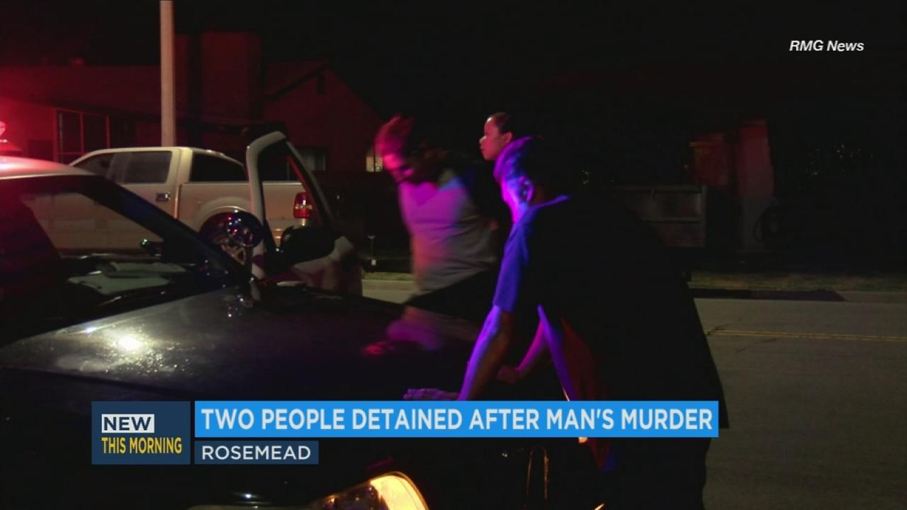 A person is detained following the fatal shooting of a man in Rosemead on Thanksgiving, Thursday, Nov. 23, 2017.