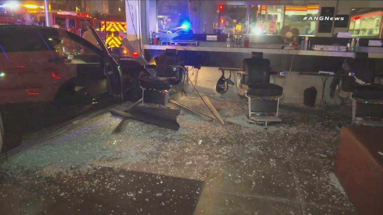Shattered glass covers a West Hollywood business after a hit-and-run on Sunday, Nov. 26, 2017.