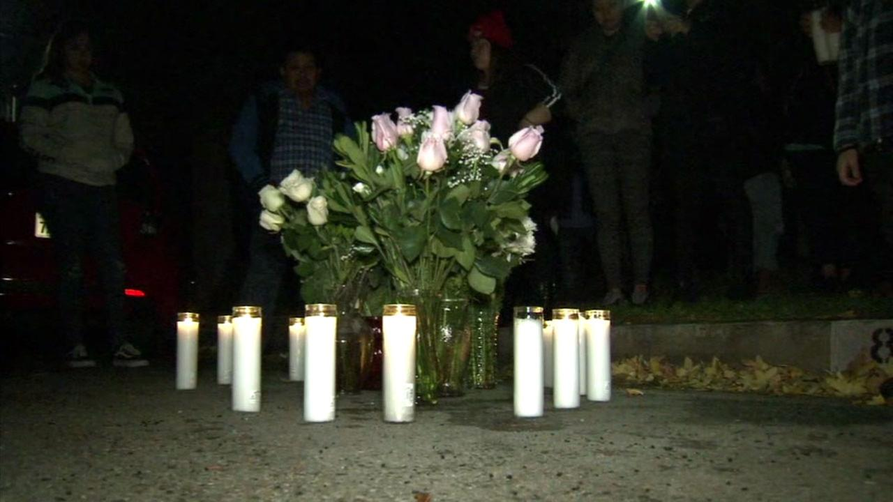 Family and friends of a North Hills mother gathered at the spot where she was killed over the weekend to honor her during a vigil on Monday, Nov. 27, 2017.