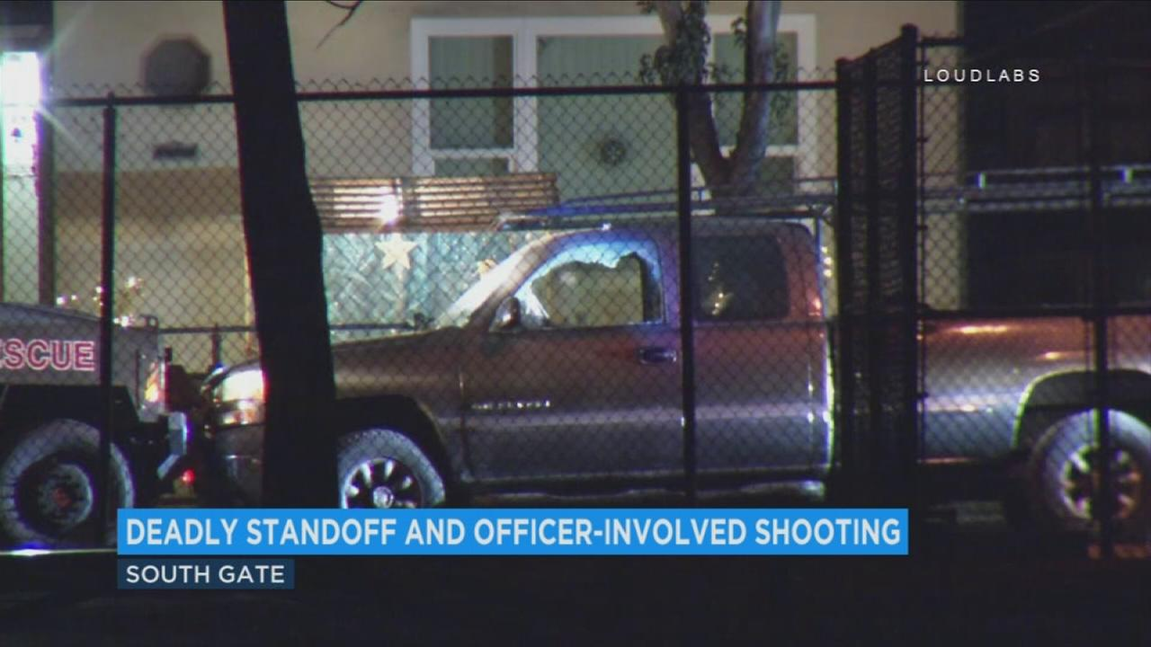 The windows of a pickup truck were shot out as a suspect engaged in a gun battle with officers in South Gate on Monday, Nov. 27, 2017.