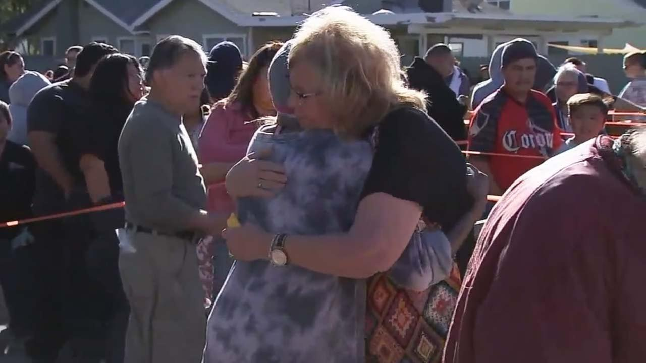 Charleen King hugs an individual during a charitable event hosted by the Christian nonprofit organization Isaiahs Rock.