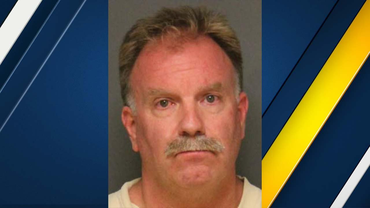Laguna Beach police Officer Rock Wagner, 58, is seen in a booking photo provided by the Fullerton Police Department.