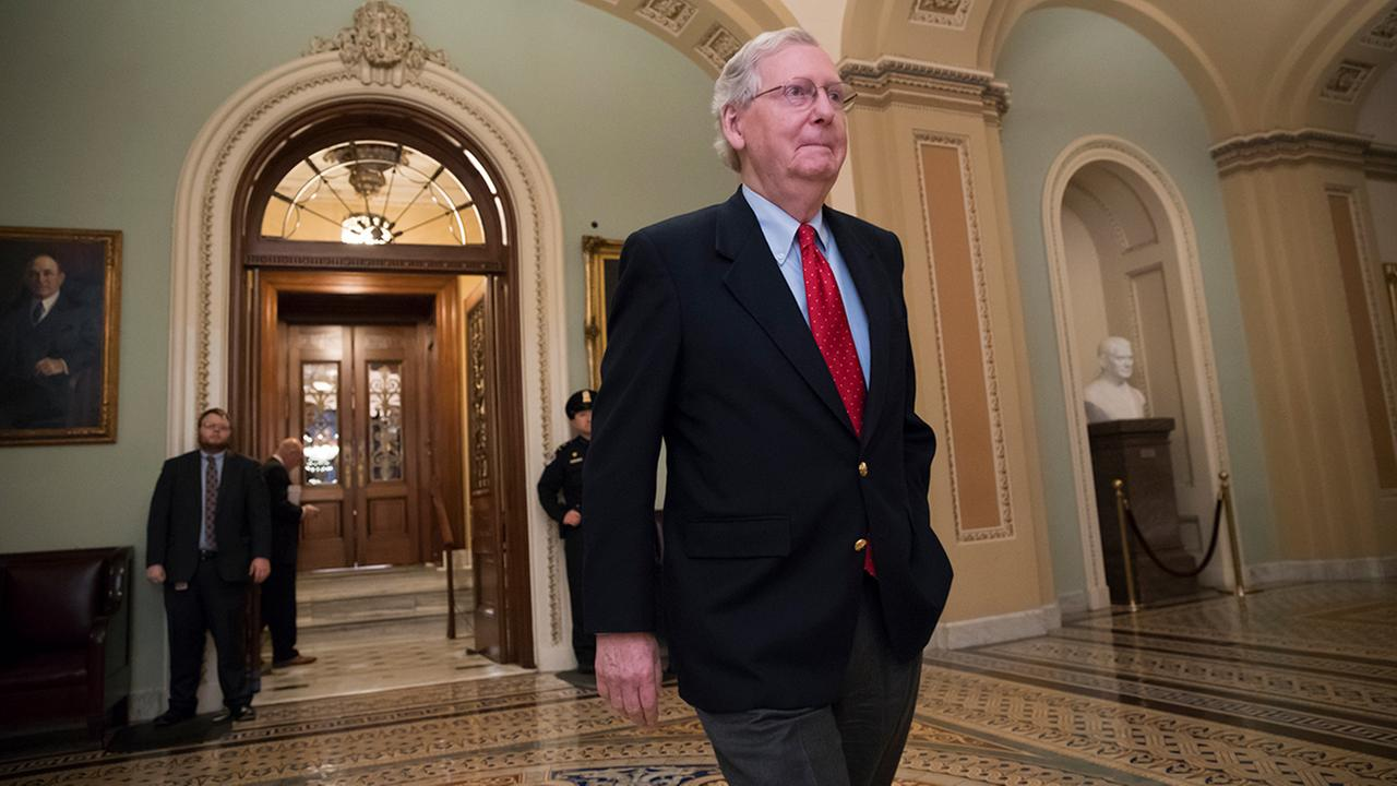 Sen. Mitch McConnell, R-Ky., walks from the chamber to his office during votes on amendments to the GOP overhaul of the tax bill, in Washington, Friday, Dec. 1, 2017.
