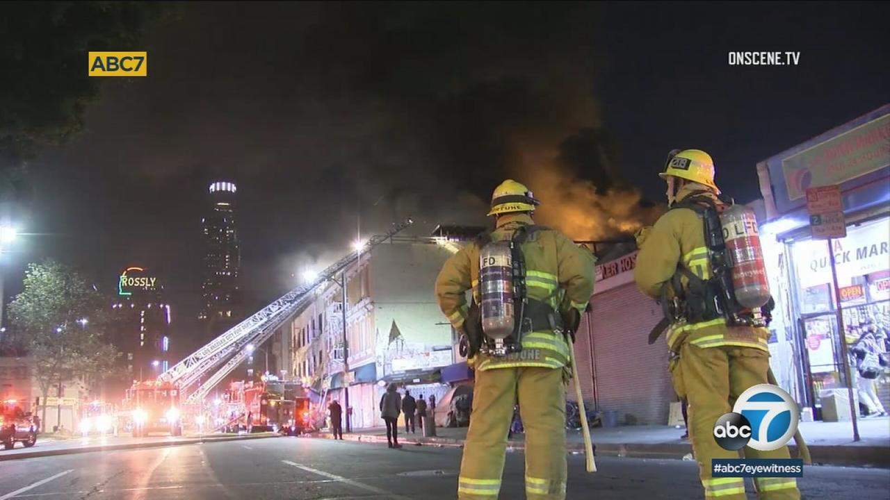 An apartment building on downtown LAs Skid Row was damaged by an early-morning fire that sent residents scattering to the street to escape the smoke and flames.