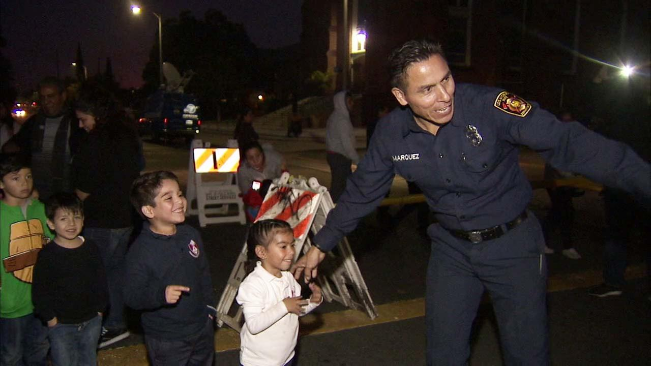 Firefighter Michael Marquez is seen helping out at a toy drive.