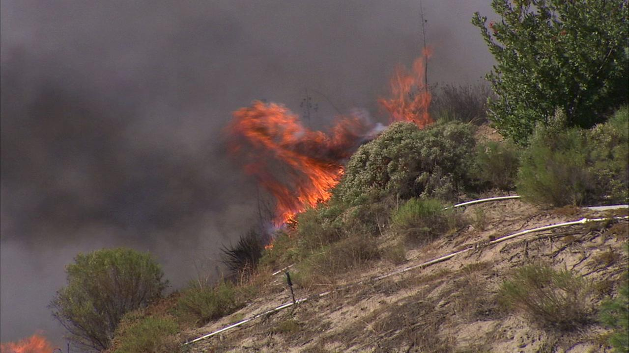 Flames moved through dry brush in Santa Clarita on a windy Tuesday.