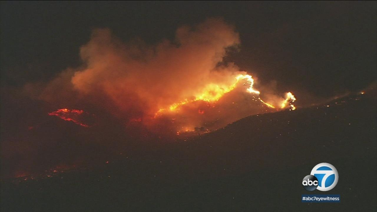 The path of the Creek Fire is shown as it burns through a hillside near Sylmar.