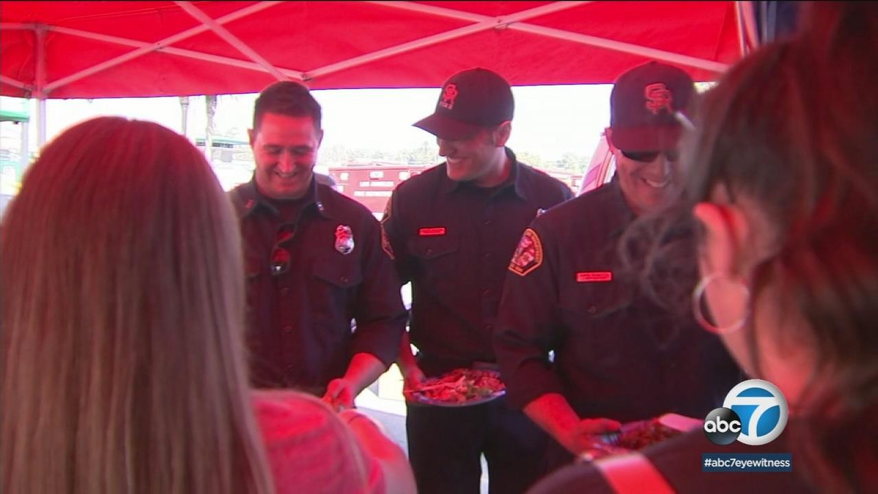 Volunteers lined up at the Skirball Fire Command Post in Westwood to help feed firefighters who were coming off grueling, exhausting shifts.