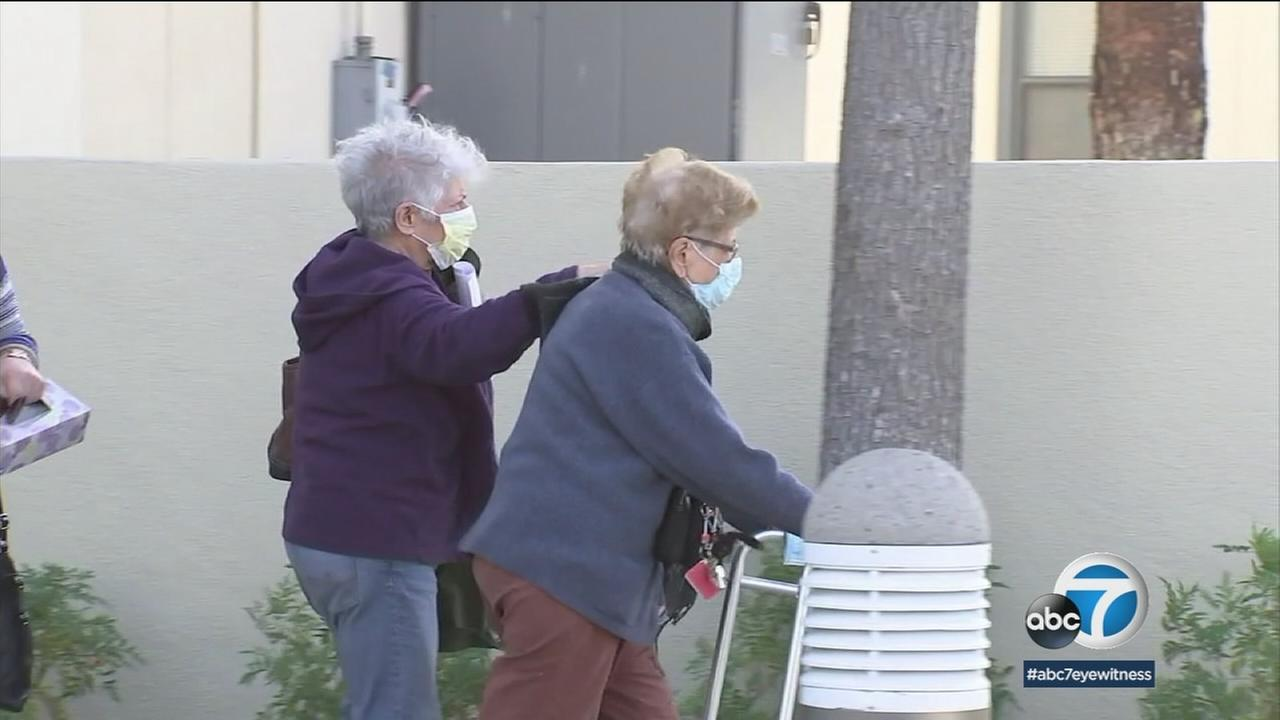 Elderly patients wearing masks are shown trying to reduce the risk of inhaling contaminants from wildfires burning in Southern California.