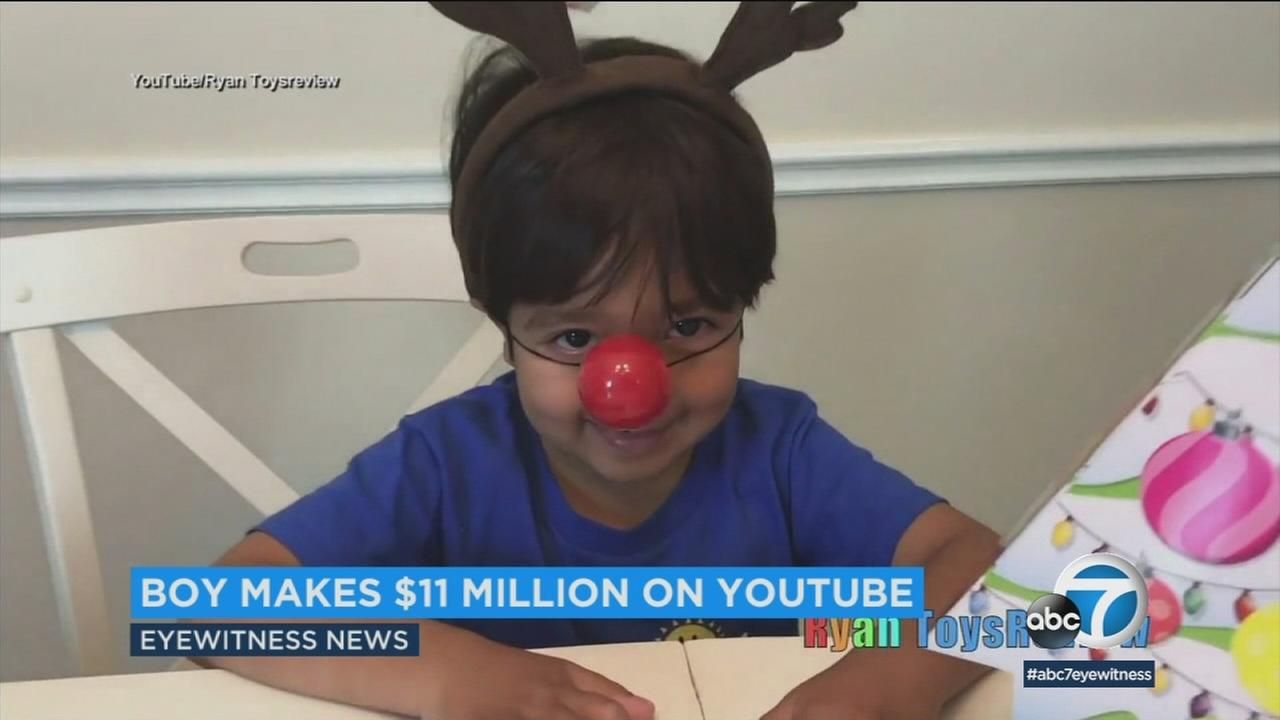 Ryan, 6, is shown in a toy review video on his popular YouTube channel that has helped him rake in millions in one year.