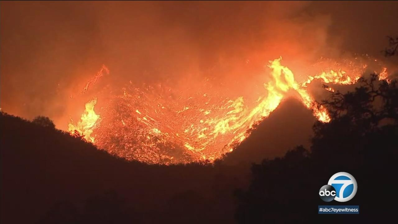 A hillside burning because of the Thomas Fire moving through Santa Barbara County is shown in a photo.
