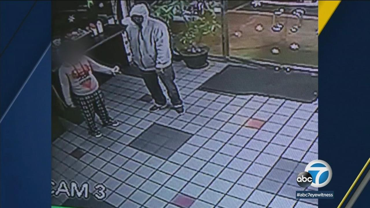 An O.C. doughnut shop worker was shot by an armed robber Wednesday. Shocking surveillance video shows the moment the victim was struck.