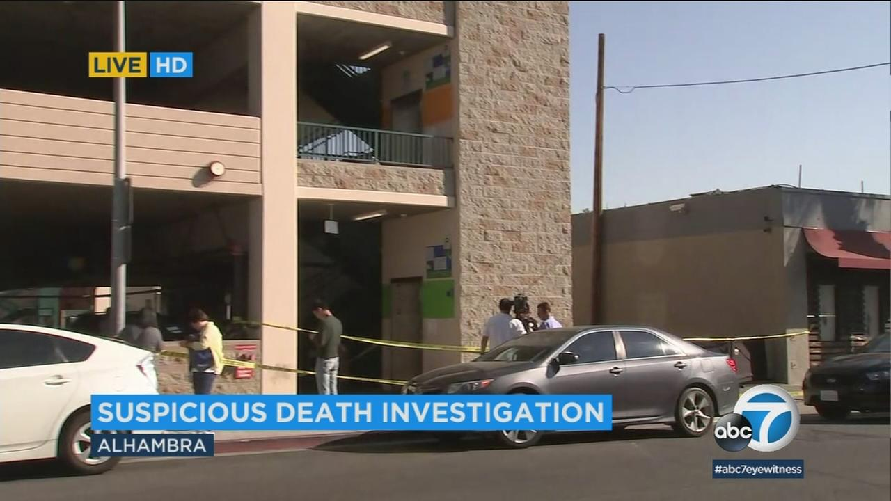 Authorities investigate the alleged murder of a woman in Alhambra on Thursday, Dec. 14, 2017.