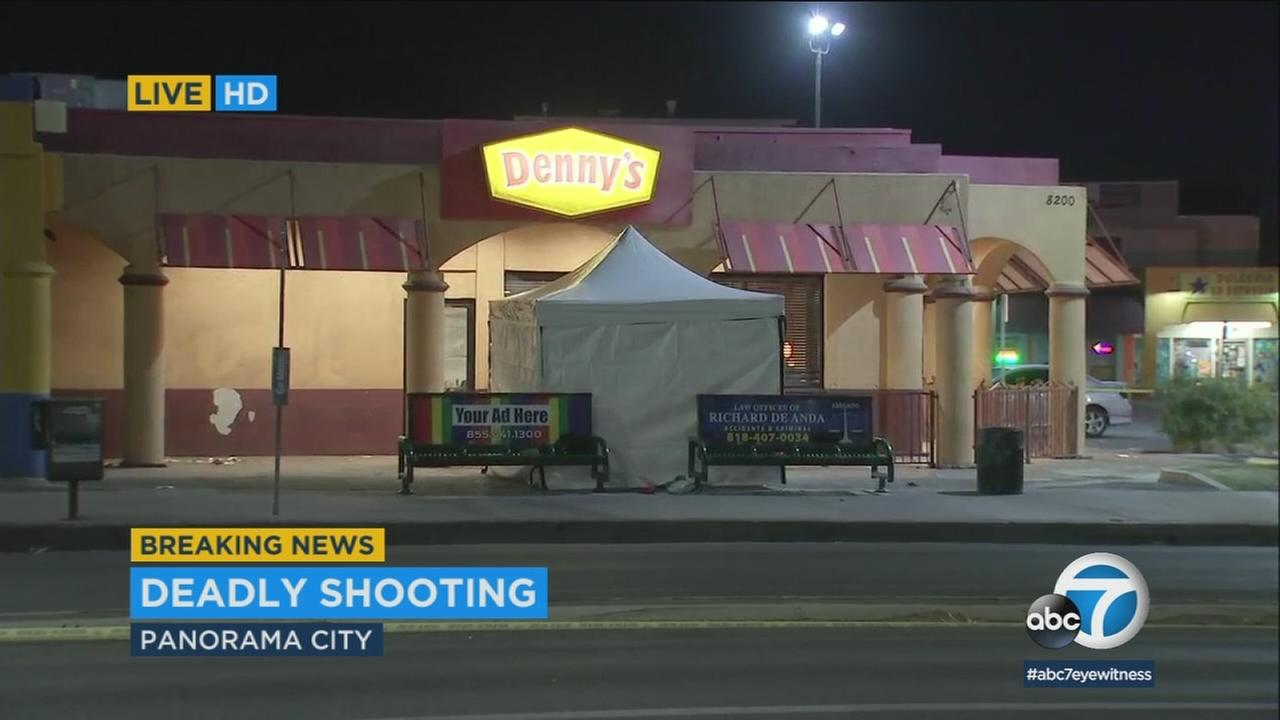 A white tent covers a deadly shooting crime scene outside of a Dennys restaurant on Friday, Dec. 15, 2017.
