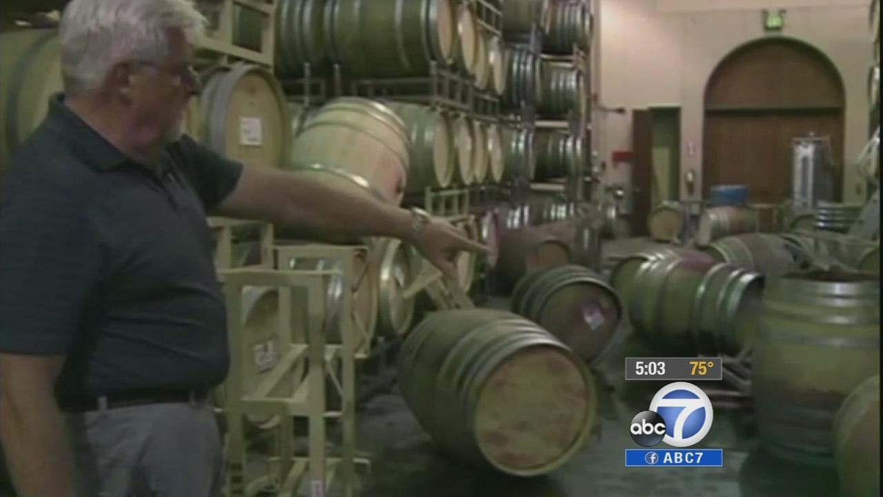 Wine barrels spill all over the ground after a 6.0-magnitude earthquake near Napa.