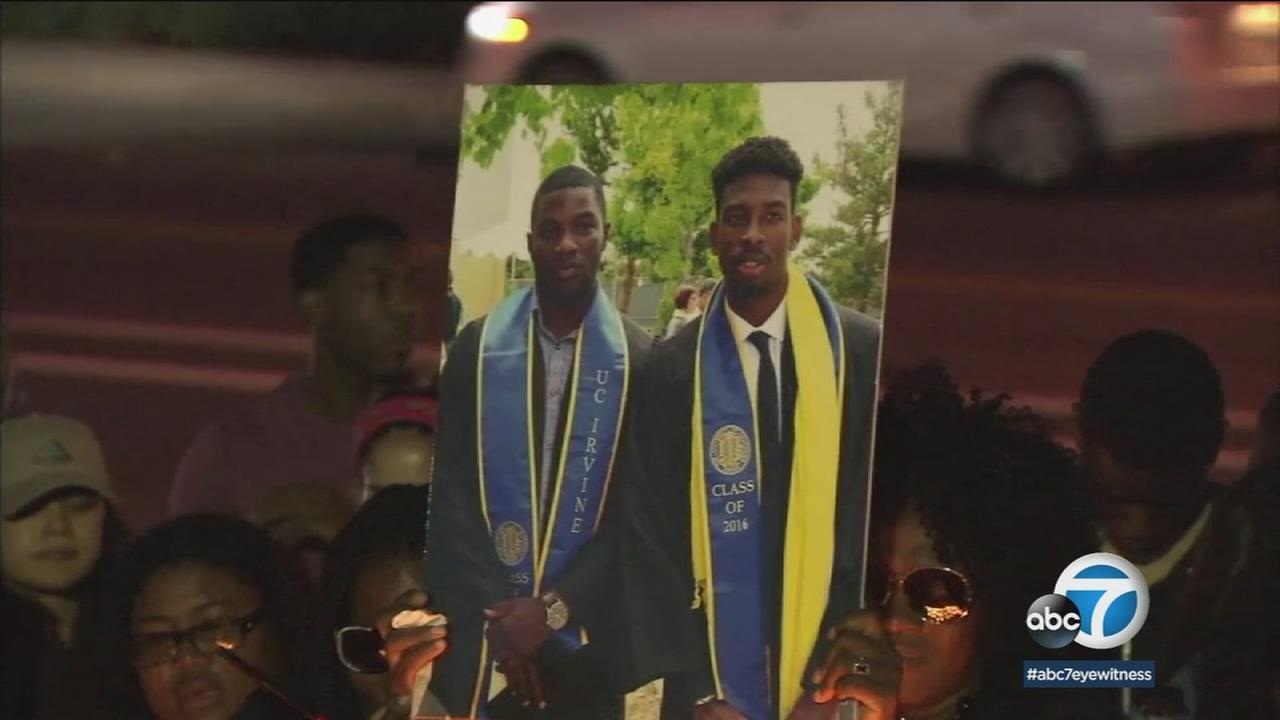 Kasean Herrera and Jeremy Shankling are shown in a photo during a memorial that was held for them.