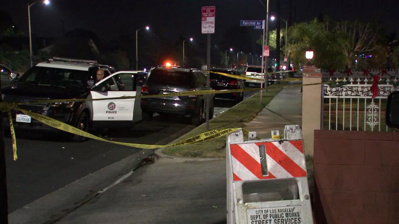 Police tape covered the scene of an officer-involved shooting that left a machete-wielding suspect dead in Canoga Park on Saturday, Dec. 23, 2017.